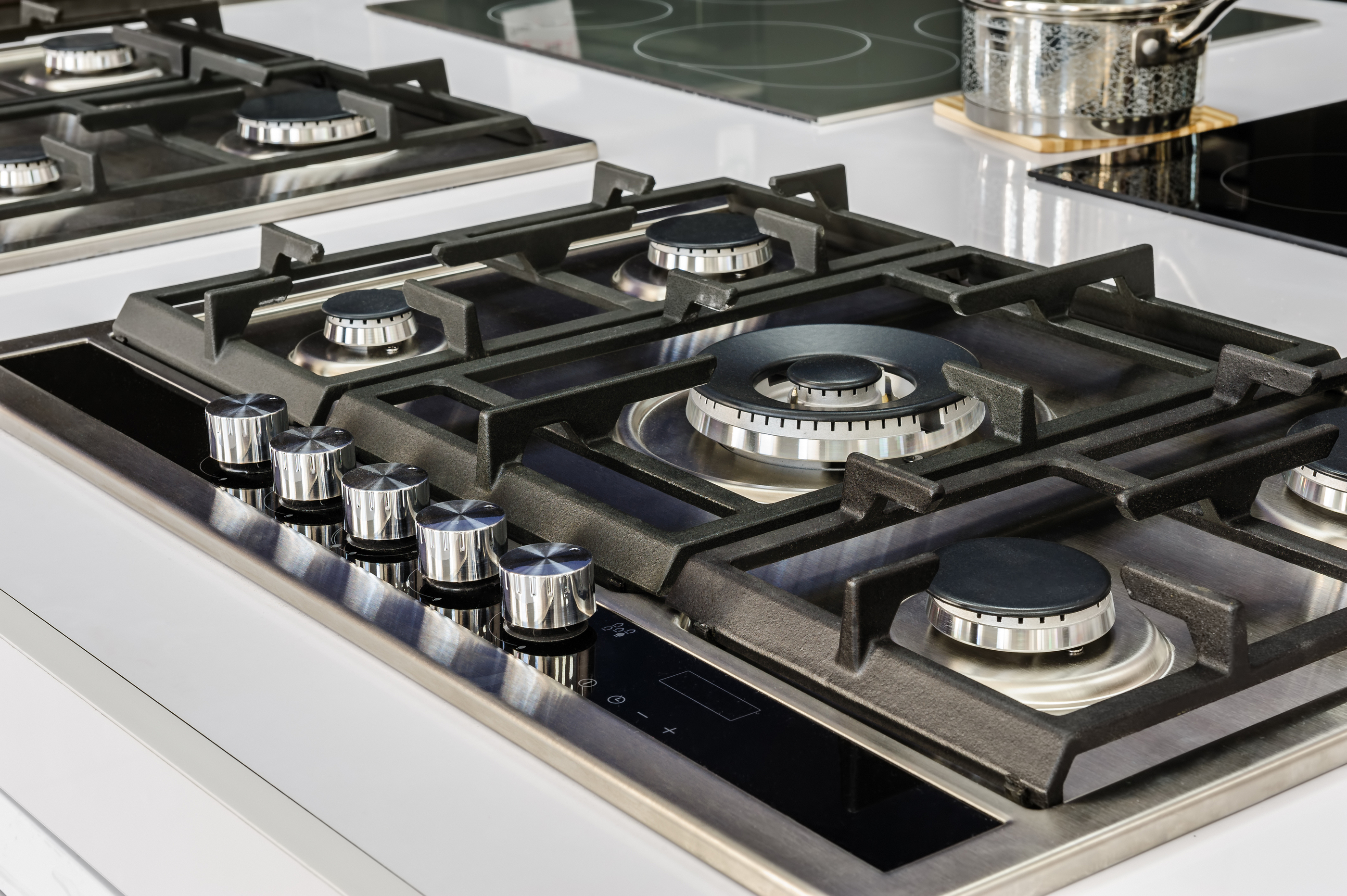 Gas stove with stainless tray selling in appliance retail store,